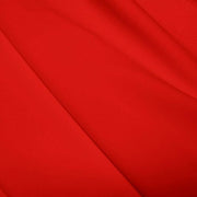 A flat sample of polyester lycra fabric in the color red.