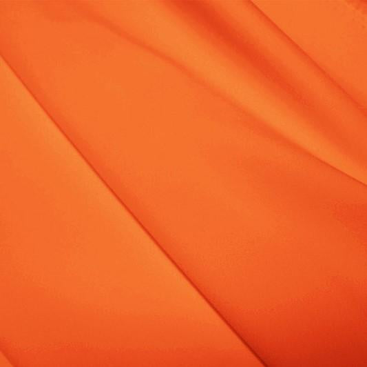 A flat sample of polyester lycra fabric in the color rust.