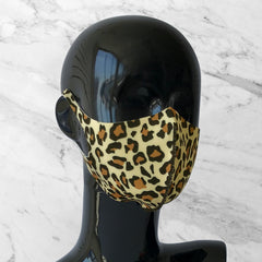 Antimicrobial face mask with cheetah print on mannequin bust.