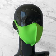 Antimicrobial face mask in neon green on mannequin bust.