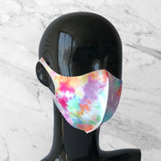 Antimicrobial face mask with tie dye print on mannequin bust.