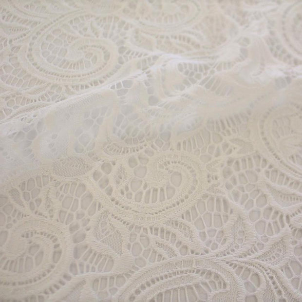 A flat sample of Adelaide stretch lace in the color white.