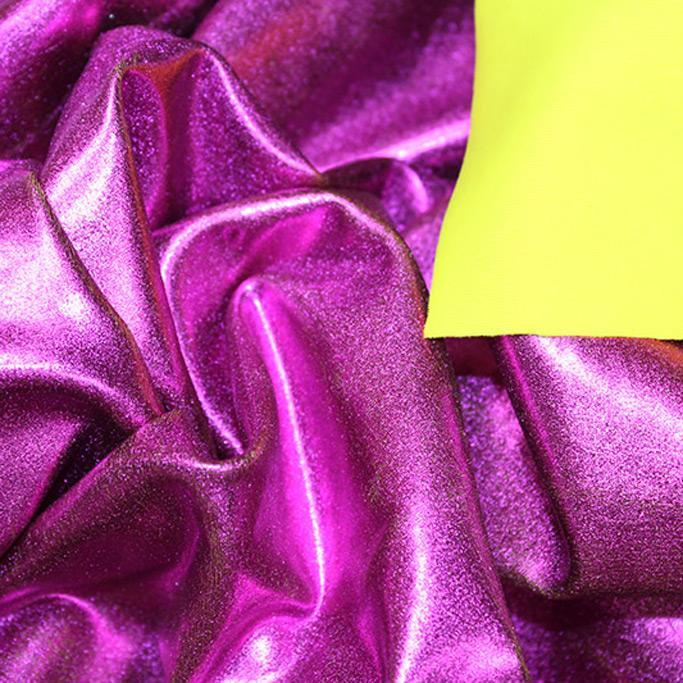 A crumpled piece of Alloy Foiled Spandex with pink foil on bumblebee spandex.