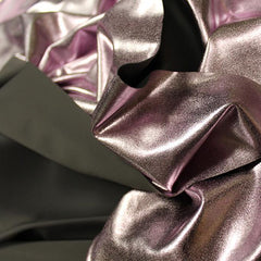 A crumpled piece of Alloy Foiled Spandex with light purple foil on graphite spandex.