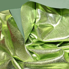 A crumpled piece of Alloy Foiled Spandex with light gree foil on sage spandex.