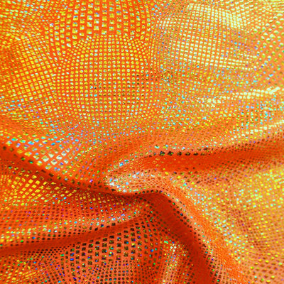 A swirled piece of Beach Ball Foiled Spandex in the color neon orange.