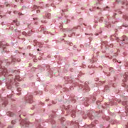A flat sample of Belle stretch mesh sequin in the color pink.