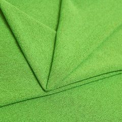 A folded piece of Blast Textured Spandex in electrime lime