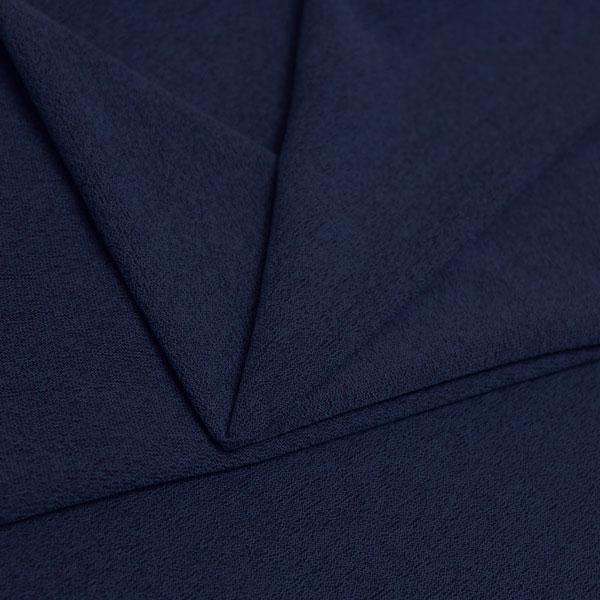 A folded piece of Blast Textured Spandex in navy.