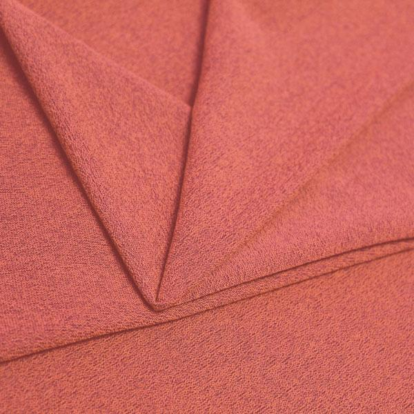 A folded piece of Blast Textured Spandex in neon coral.