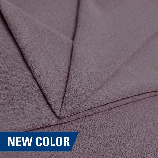 A folded piece of Blast Textured Spandex in purple haze.