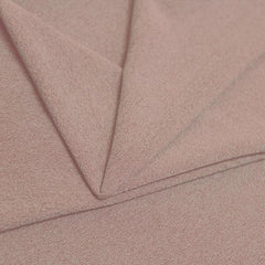 A folded piece of Blast Textured Spandex in rosy peach.