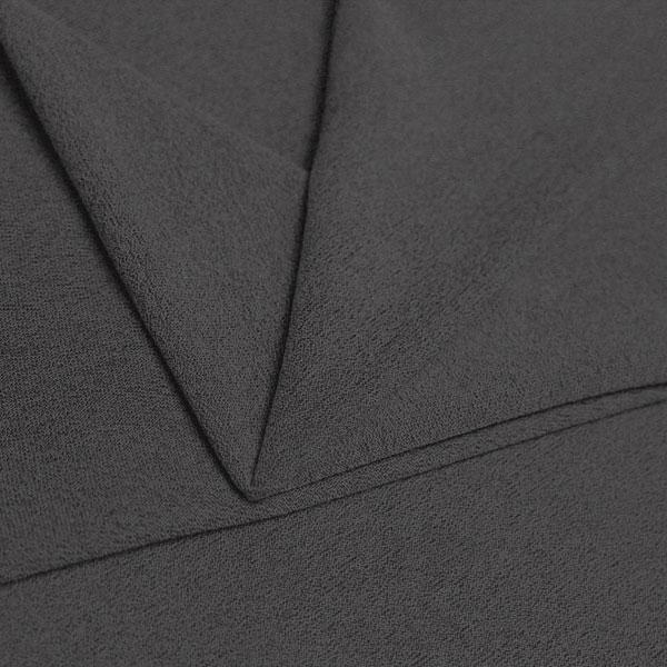 A folded piece of Blast Textured Spandex in slate grey.