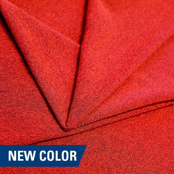 A folded piece of Blast Textured Spandex in solar orange.