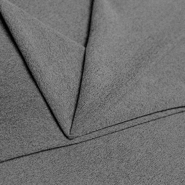 A folded piece of Blast Textured Spandex in stone.