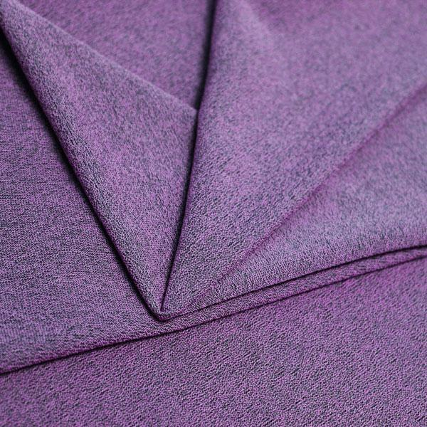 A folded piece of Blast Textured Spandex in vivid violet.