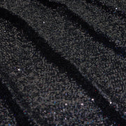 A panel of Cosmic GLOW spandex sequin in black