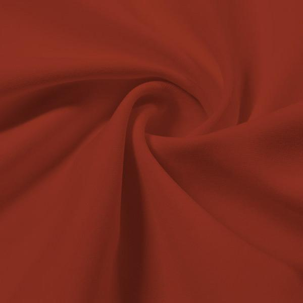 A swirled piece of Energize Activewear Nylon Spandex in the color picante.