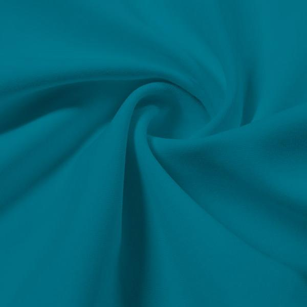 A swirled piece of Energize Activewear Nylon Spandex in the color tropic teal.