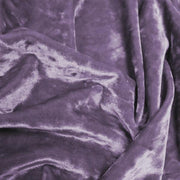 A crumpled pieces of Frozen Crushed Stretch Velvet in the color purple haze
