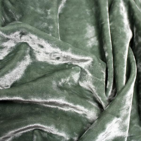 A crumpled pieces of Frozen Crushed Stretch Velvet in the color sage green
