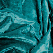 A crumpled pieces of Frozen Crushed Stretch Velvet in the color teal green