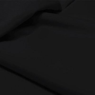 A flat sample of allure polyester spandex in the color black.