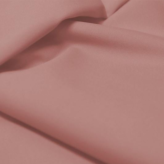 A flat sample of allure polyester spandex in the color champagne.