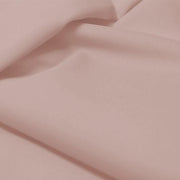 A flat sample of allure polyester spandex in the color cheeky.