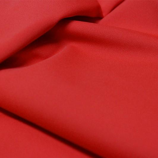 A flat sample of allure polyester spandex in the color classic car red.