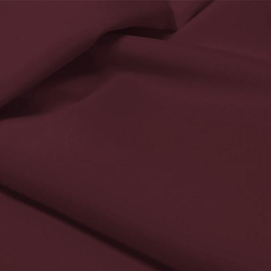 A flat sample of allure polyester spandex in the color fig.