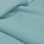 A flat sample of allure polyester spandex in the color sunday blue.