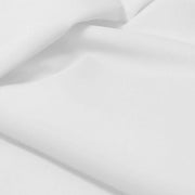 A flat sample of allure polyester spandex in the color white.