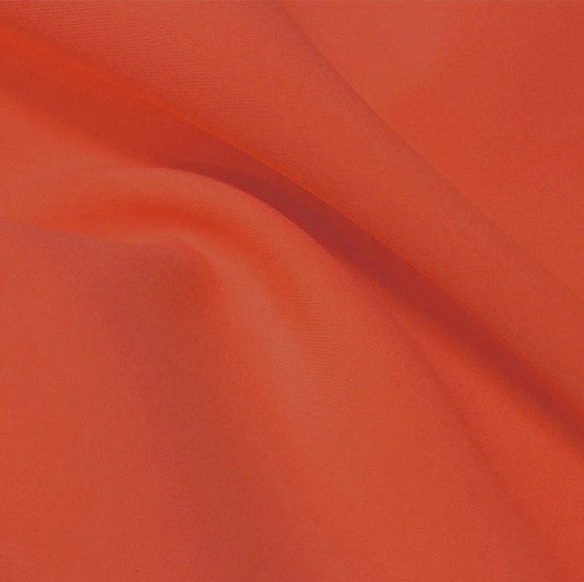 A flat sample of flexfilt recycled polyester spandex in the color burnt sienna.