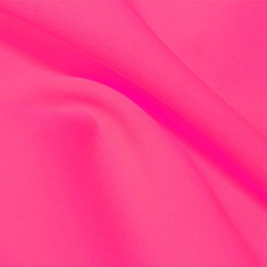 A flat sample of flexfilt recycled polyester spandex in the color knockout pink .
