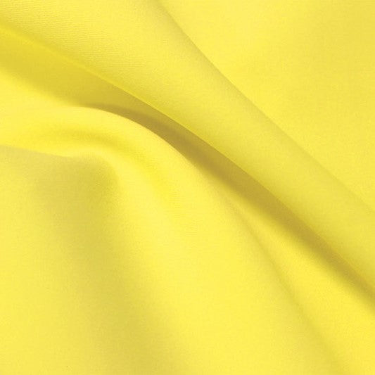 A flat sample of flexfilt recycled polyester spandex in the color low key lemon.