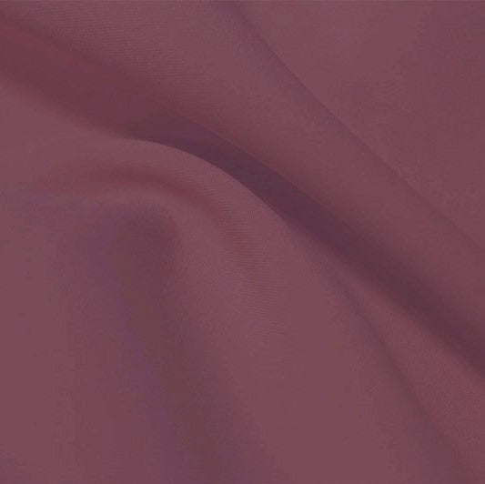 A flat sample of flexfilt recycled polyester spandex in the color mindful mauve.
