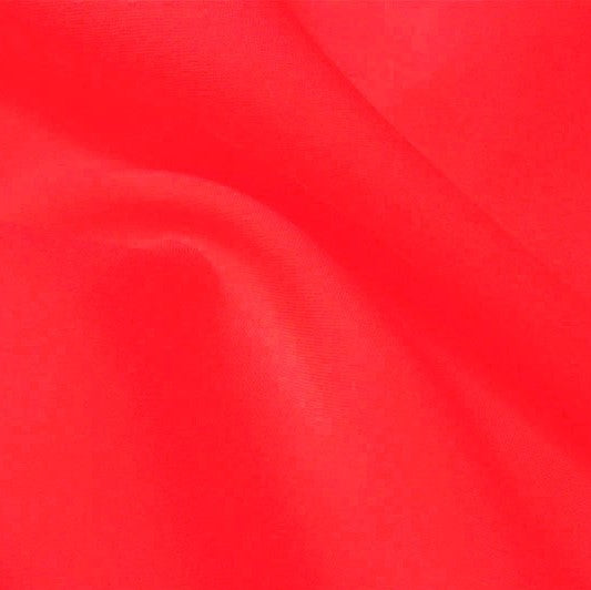 A flat sample of flexfilt recycled polyester spandex in the color watermelon.
