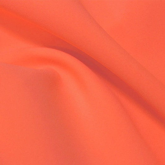 A flat sample of flexfilt recycled polyester spandex in the color peach berry.