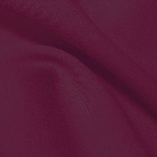 A flat sample of flexfilt recycled polyester spandex in the color purple plum.