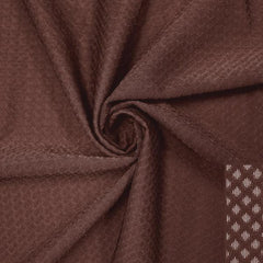 A swirled piece of Hive Textured Spandex in the color cocoa brown.