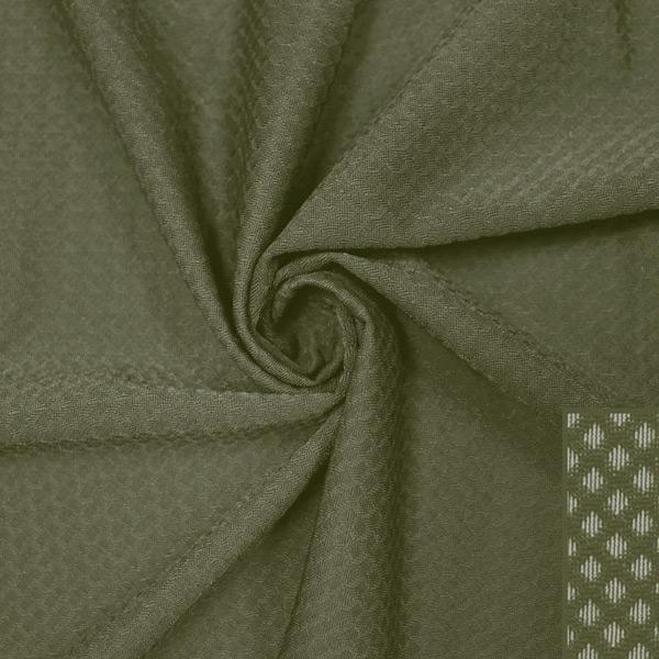 A swirled piece of Hive Textured Spandex in the color dusty olive.