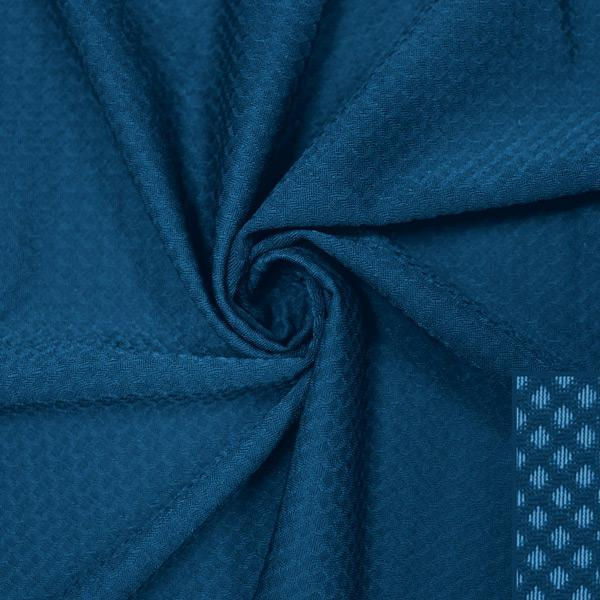 A swirled piece of Hive Textured Spandex in the color empathy.