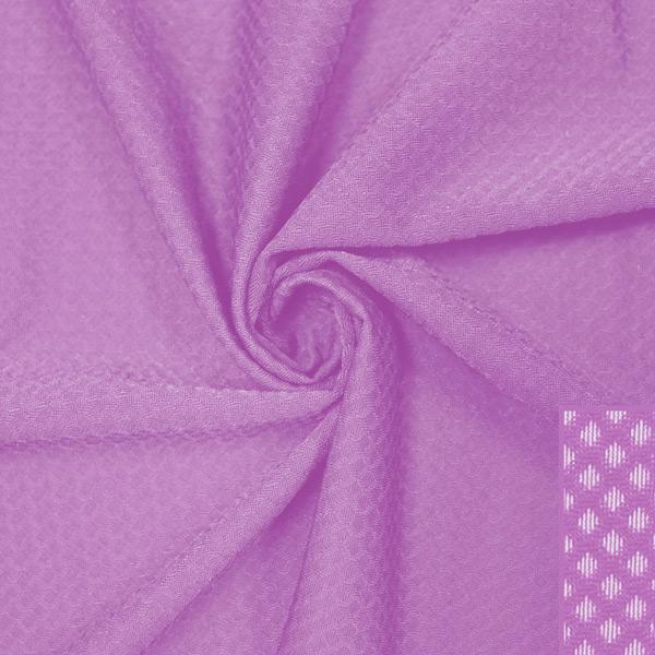 A swirled piece of Hive Textured Spandex in the color festival.