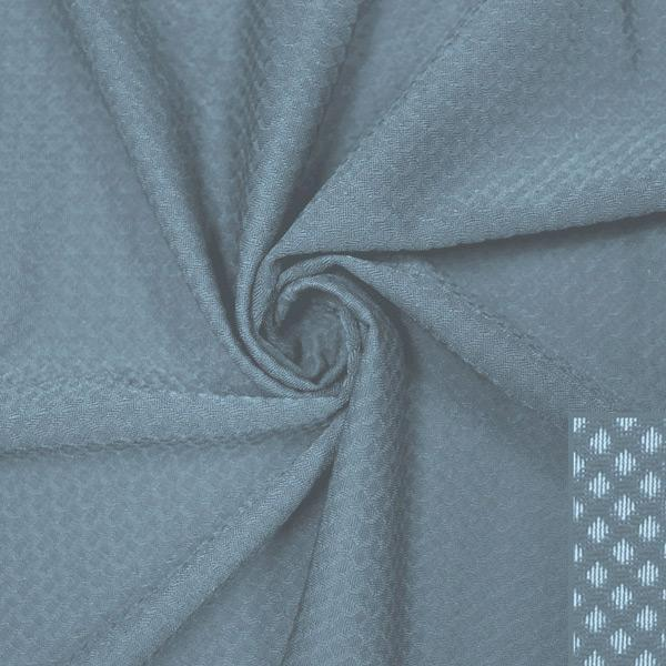A swirled piece of Hive Textured Spandex in the color mist.