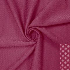 A swirled piece of Hive Textured Spandex in the color mulberry.