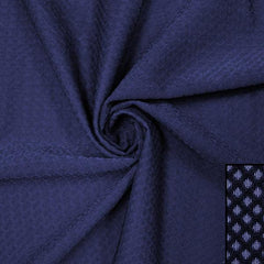 A swirled piece of Hive Textured Spandex in the color navy.