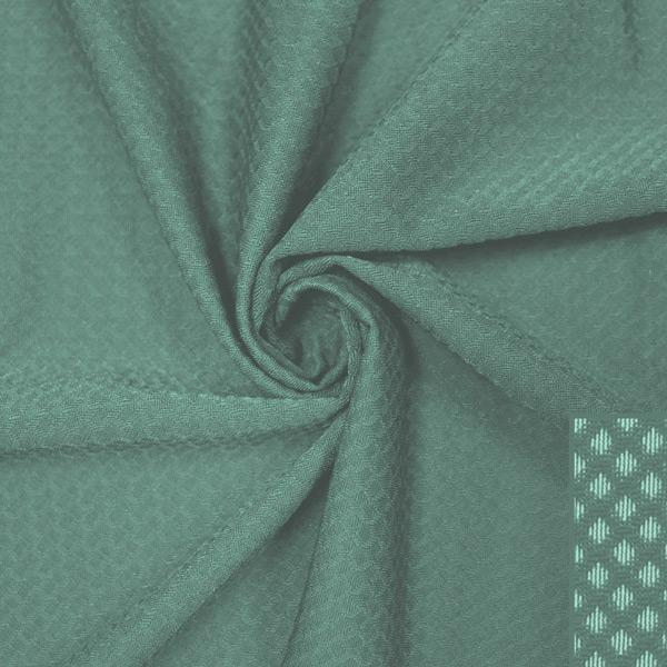 A swirled piece of Hive Textured Spandex in the color pale cacti.