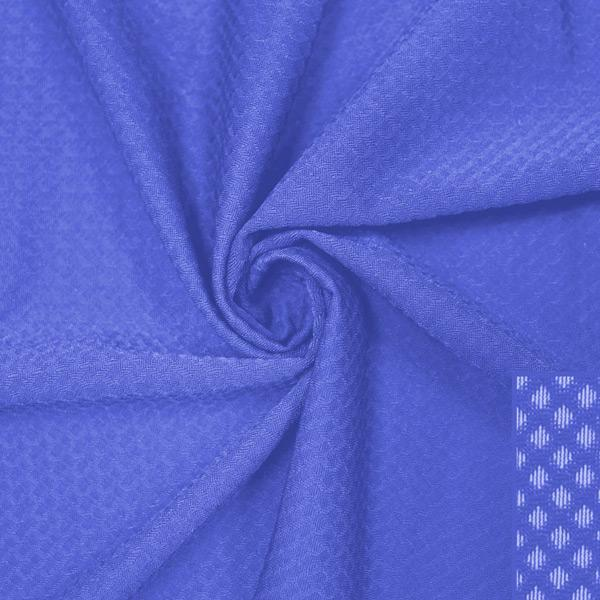 A swirled piece of Hive Textured Spandex in the color periwinkle.