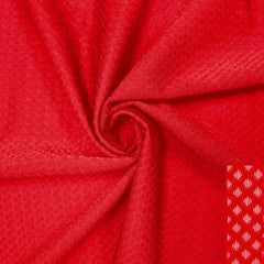 A swirled piece of Hive Textured Spandex in the color red.